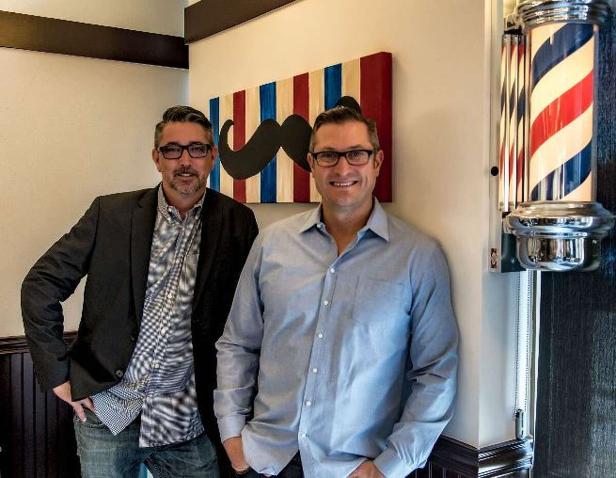 Scott Finley, left, and Darren Peterson are founders of the Finley's Barber Shop chain.