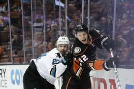 Anaheim Ducks' Josh Manson, right, is shoved by San Jose Sharks' Joonas Donskoi, of Finland, during the first period of an NHL hockey game Friday, Dec. 9, 2016, in Anaheim, Calif. (AP Photo/Jae C. Hong)