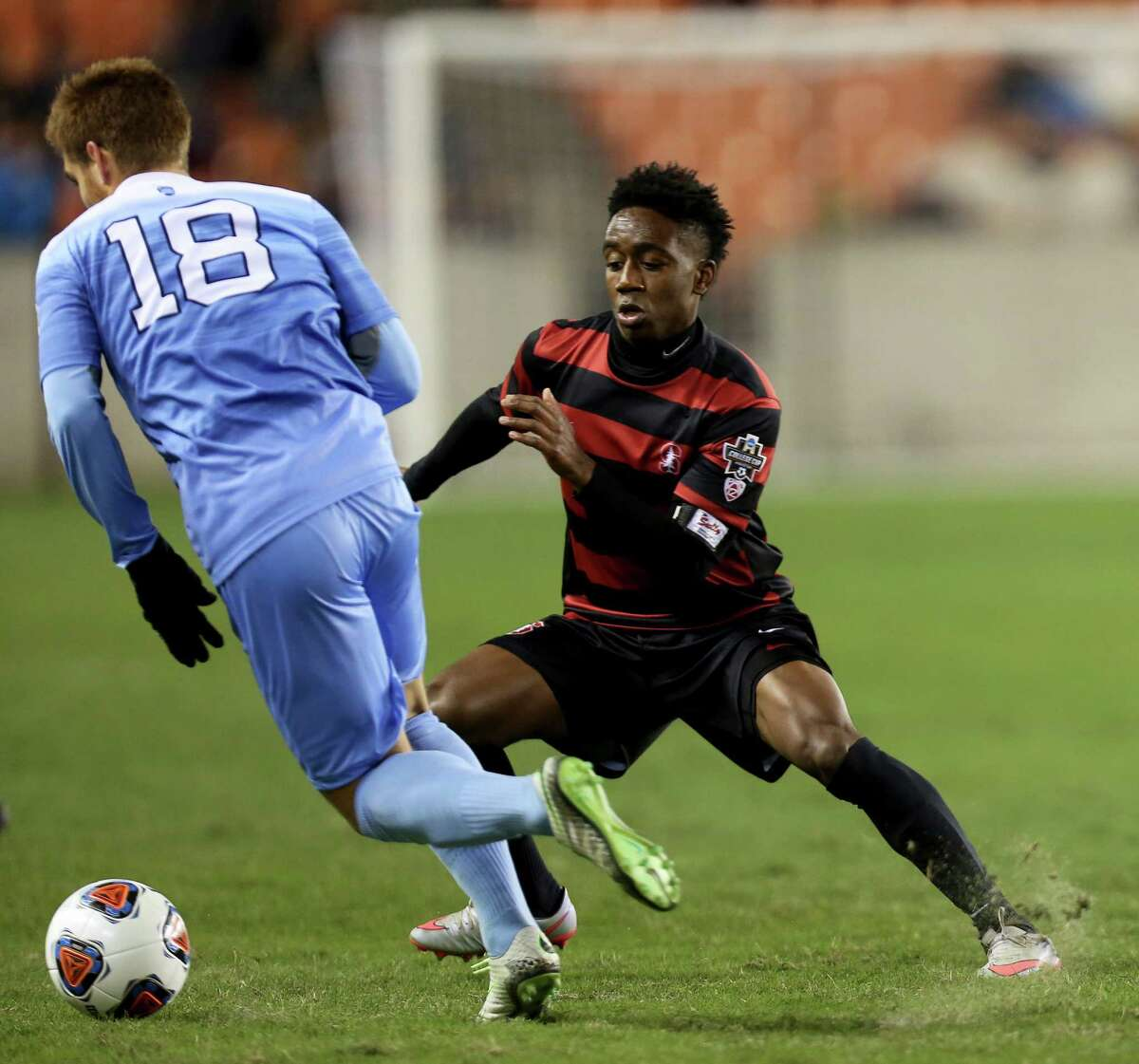 North Carolina's Alan Winn, left, tries to elude the defense of Stanford's Bryce Marion in the first half of Stanford's shootout win at BBVA Compass Stadium.