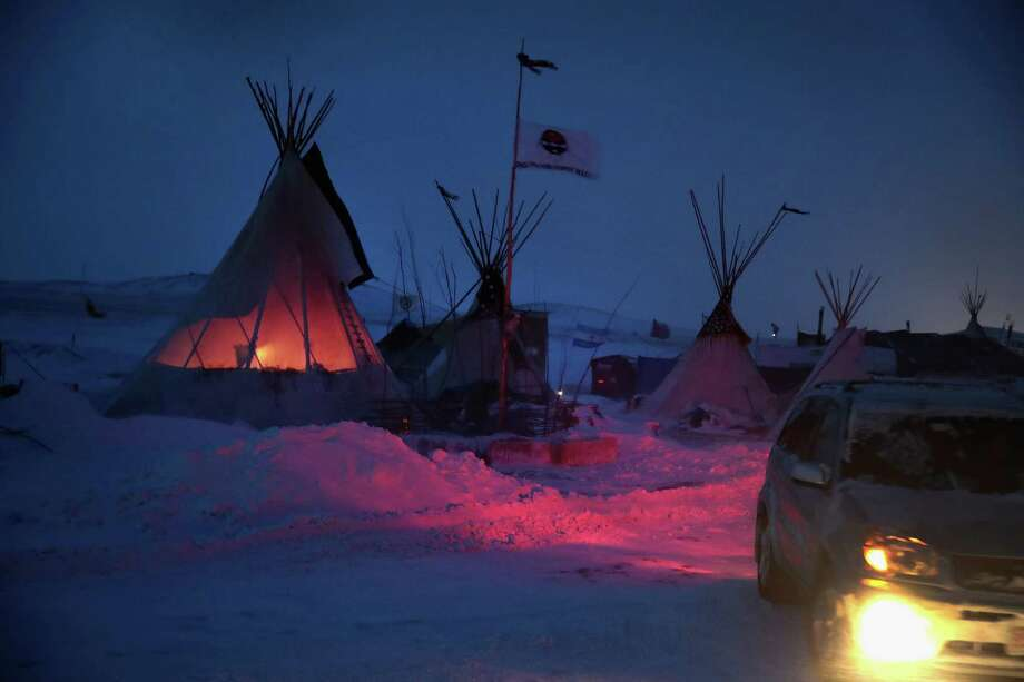 CANNON BALL, ND - DECEMBER 06:  Activists at Oceti Sakowin near the Standing Rock Sioux Reservation brace for sub-zero temperatures expected overnight on December 6, 2016 outside Cannon Ball, North Dakota. Native Americans and activists from around the country have been at the camp for several months trying to halt the construction of the Dakota Access Pipeline. The proposed 1,172-mile-long pipeline would transport oil from the North Dakota Bakken region through South Dakota, Iowa and into Illinois.  (Photo by Scott Olson/Getty Images) Photo: Scott Olson, Staff / 2016 Getty Images