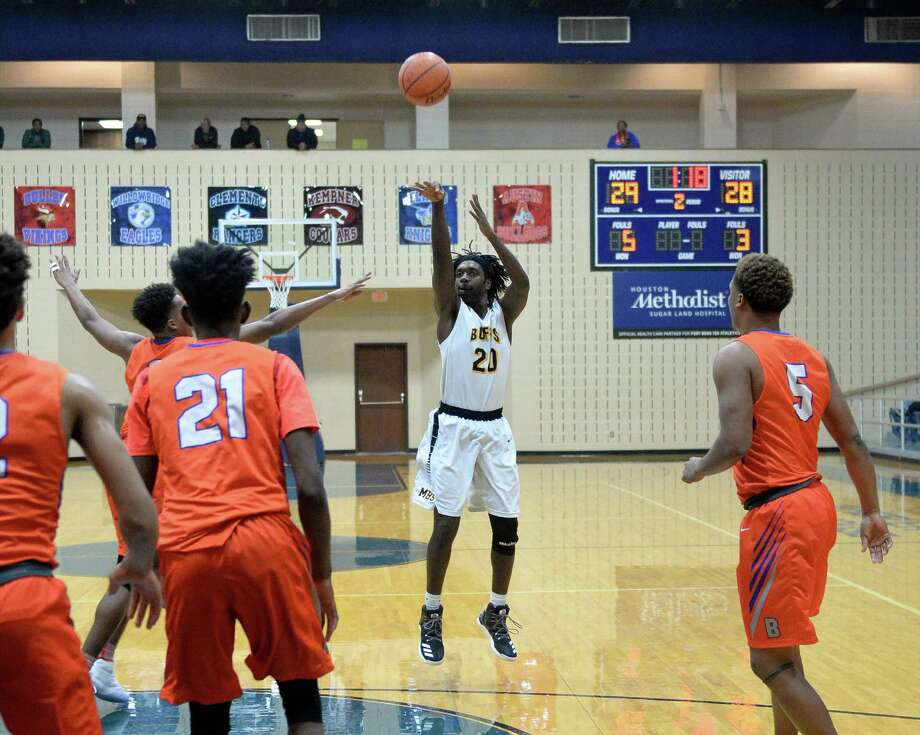 Jack Moore (20) of Marshall attempts a jump shot during the first half of a basketball game between the Ft. Bend Marshall Buffalos and the Arlington Bowie Volunteers at the Ft. Bend ISD Tournament on Friday December 9, 2016, Wheeler Fieldhouse, Sugar Land, TX. Photo: Craig Moseley, Houston Chronicle / ©2016 Houston Chronicle