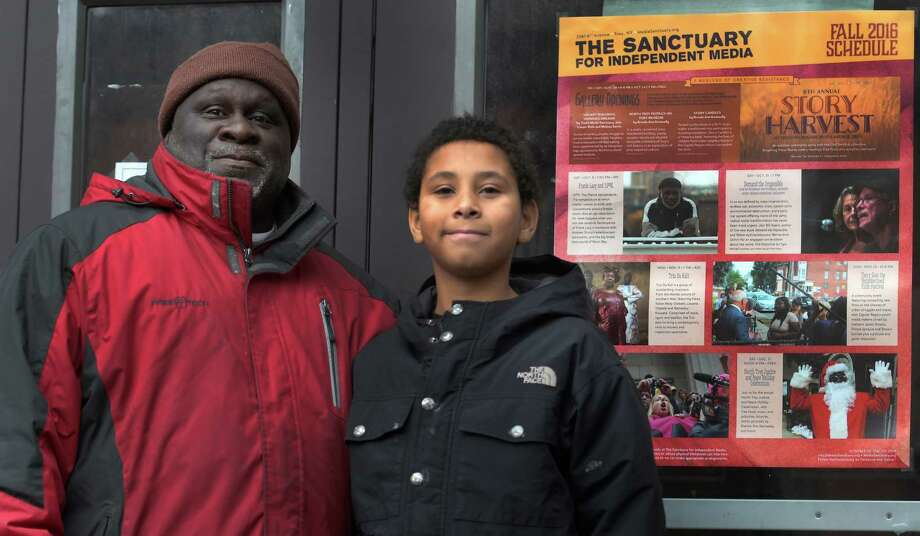 Mac Henderson stands with his son Joshua Henderson, 11,  outside the Sanctuary for Independent Media Wednesday  Dec. 7, 2016 In Troy, N.Y. (Skip Dickstein/Times Union) Photo: SKIP DICKSTEIN / 20039079A