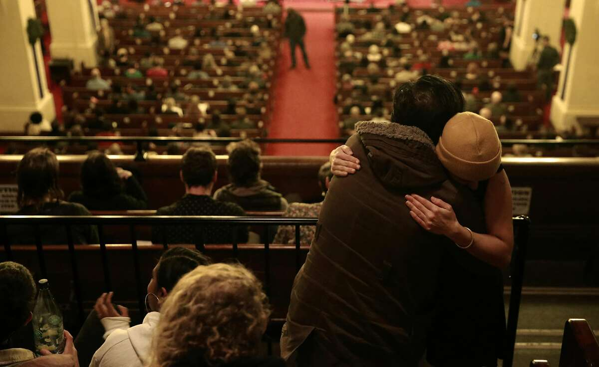 """Friends embrace as Laney College's Oakland City Chorus holds """"A Time for Reflection"""" at the First Presbyterian Church in Oakland, California, on Friday December 9, 2016. The benefit was held for chorus member Denalda Siegrist and other victims who perished in the Ghost Ship warehouse fire."""