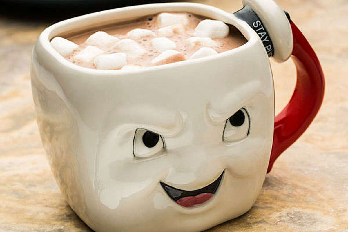 """Ghostbusters Stay Puft Mug Price: $14.99 You'll note that this wasn't explicitly listed as a coffee mug, which we're taking as a tacit admission that it makes more sense to drink hot cocoa from a ceramic Stay Puft head. Marshmallows from a marshmallow! The 20-oz. mug is double-sided, with one side showing an """"angry"""" Stay Puft, and the other side depicting his gentler side. Any cup capable of signaling multiple emotions makes a neat gift in our book, so the fact that this one looks like the Stay Puft Marshmallow Man just makes it an easier sell."""