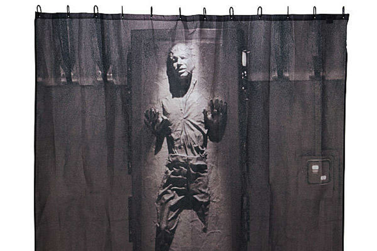 Han Solo in Carbonite Shower Curtain Price: $24.99 Your '80s baby can decorate like Jabba the Hutt with this Star Wars shower curtain, featuring Han Solo frozen in carbonite. Some may feel a little uneasy undressing in front of Han, but we're pretty sure that nobody can see through carbonite.