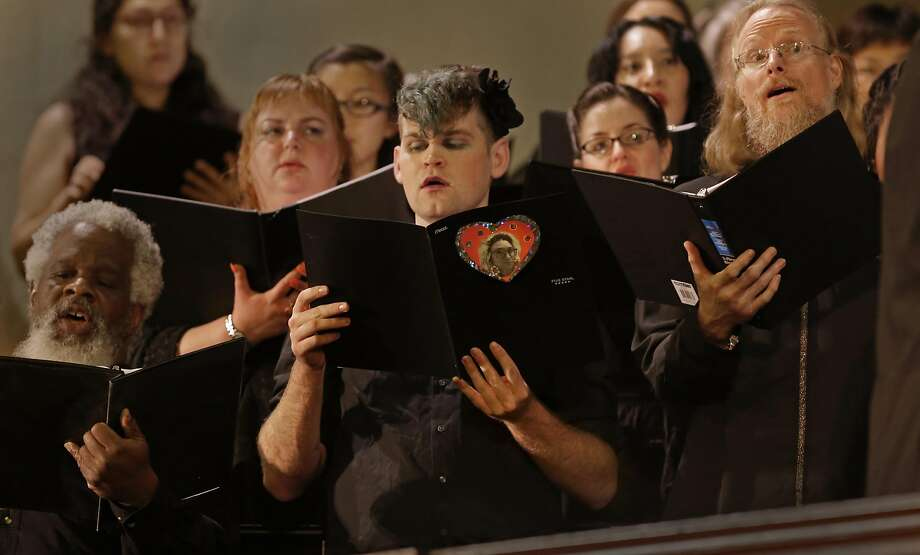 "Tenor, Yacob McCann holds his song book containing a photo of his friend and fellow chorus member Denalda Siegrist during the performance as Laney College's Oakland City Chorus holds "" A Time for Reflection"" at the First Presbyterian Church in Oakland, California, on Friday  December 9, 2016. The benefit was held for chorus member Denalda Siegrist and other victims who perished in the Ghost Ship warehouse fire. Photo: Michael Macor, The Chronicle"