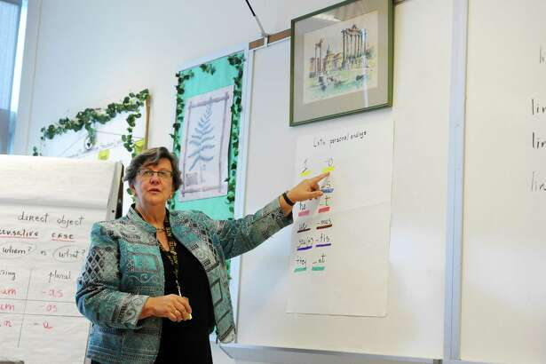 Language teacher Ana Koltypin goes through Latin personal endings during a class at AITE High School in Stamford.