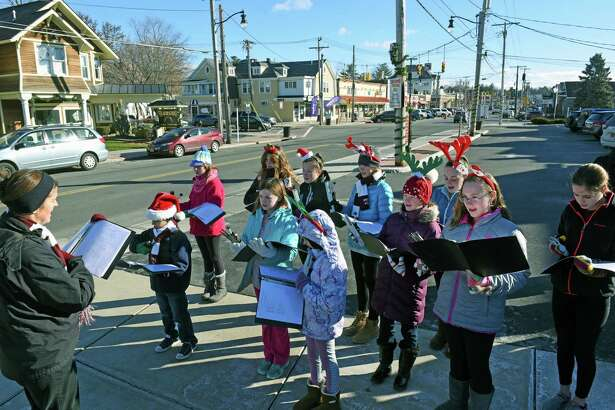 Music director Jonina Wilkins leads Brown School students in holiday carolling along Upper Union Street  on Saturday Dec. 10, 2016 in Schenectady, N.Y. (Michael P. Farrell/Times Union)