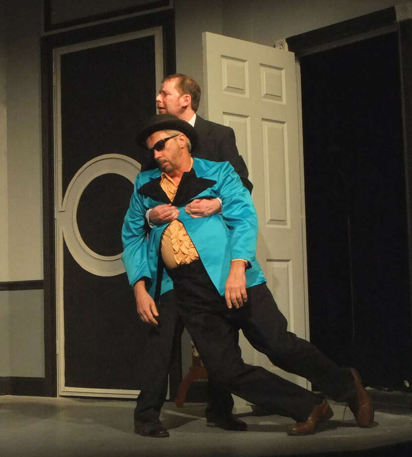 """Kris Anderson, rear, and Dennis Skiba in """"Out of Order"""" at Curtain Call Theatre. (CCT publicity photo)"""