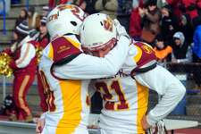 St. Joseph's Josh Menard, left, embraces teammate Mike Dilorio on the sidelines after being defeated by Hillhouse Saturday.