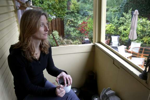 "Marlene Deel sits on the backyard porch of her home in Oakland, Calif. on Saturday, Dec. 10, 2016. Deel loved to cook with her partner, James ""J.J."" Lucas, but his life ended in a tragic motorcycle accident in August."