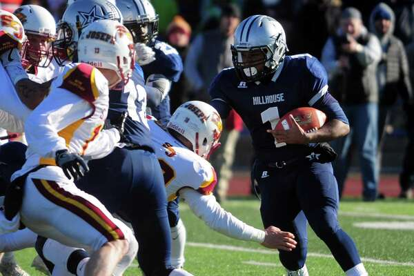 Hillhouse's Matthew Brehon carries the ball during Class M Championship football action against St. Joseph in West Haven, Conn. on Saturday Dec. 10, 2016. Final score: 42-21.