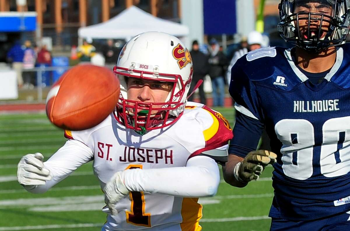 St. Joseph's Ace Luzietti can't complete a pass during Class M Championship football action against Hillhouse in West Haven, Conn. on Saturday Dec. 10, 2016. Hillhouse defeated St. Joseph 42-21.