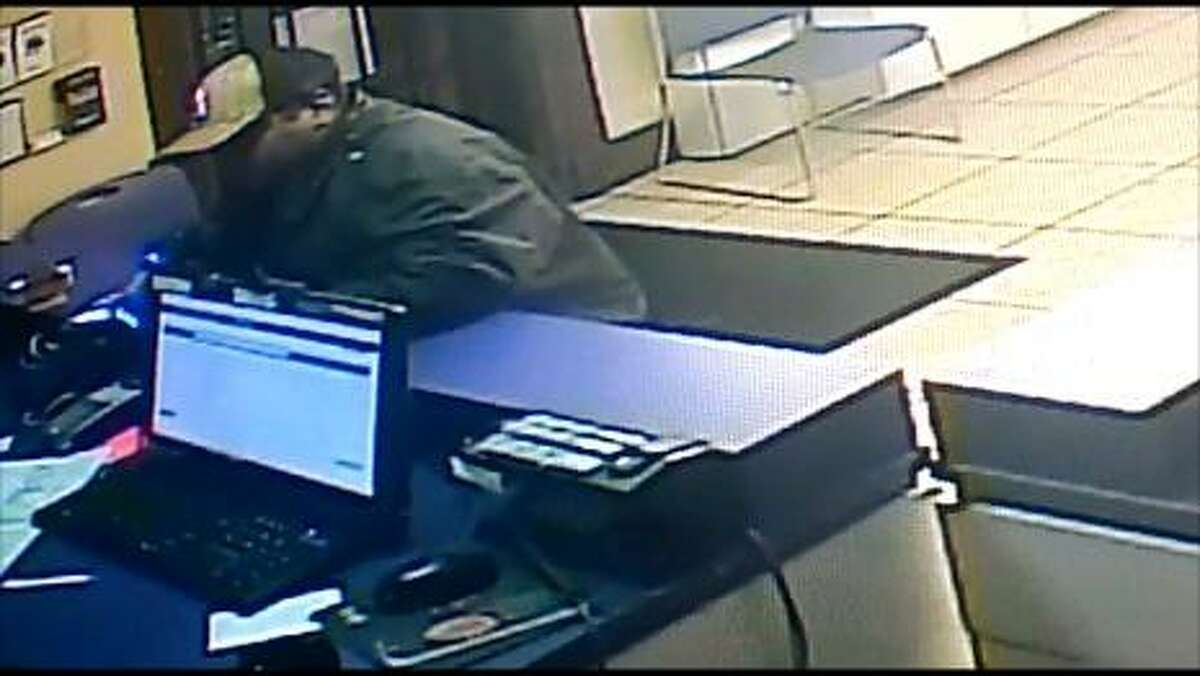 Laredo police said this man in the photos pulled out a Taser to rob a local Metro PCS store.