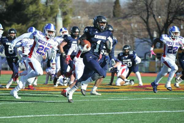 Markell Dobbs (1) of the Ansonia Chargers breaks free for a touchdown in the first quarter of the Class S State Championship Game against the Rocky Hill Terriers on December 10, 2016 in New Britain, Connecticut.