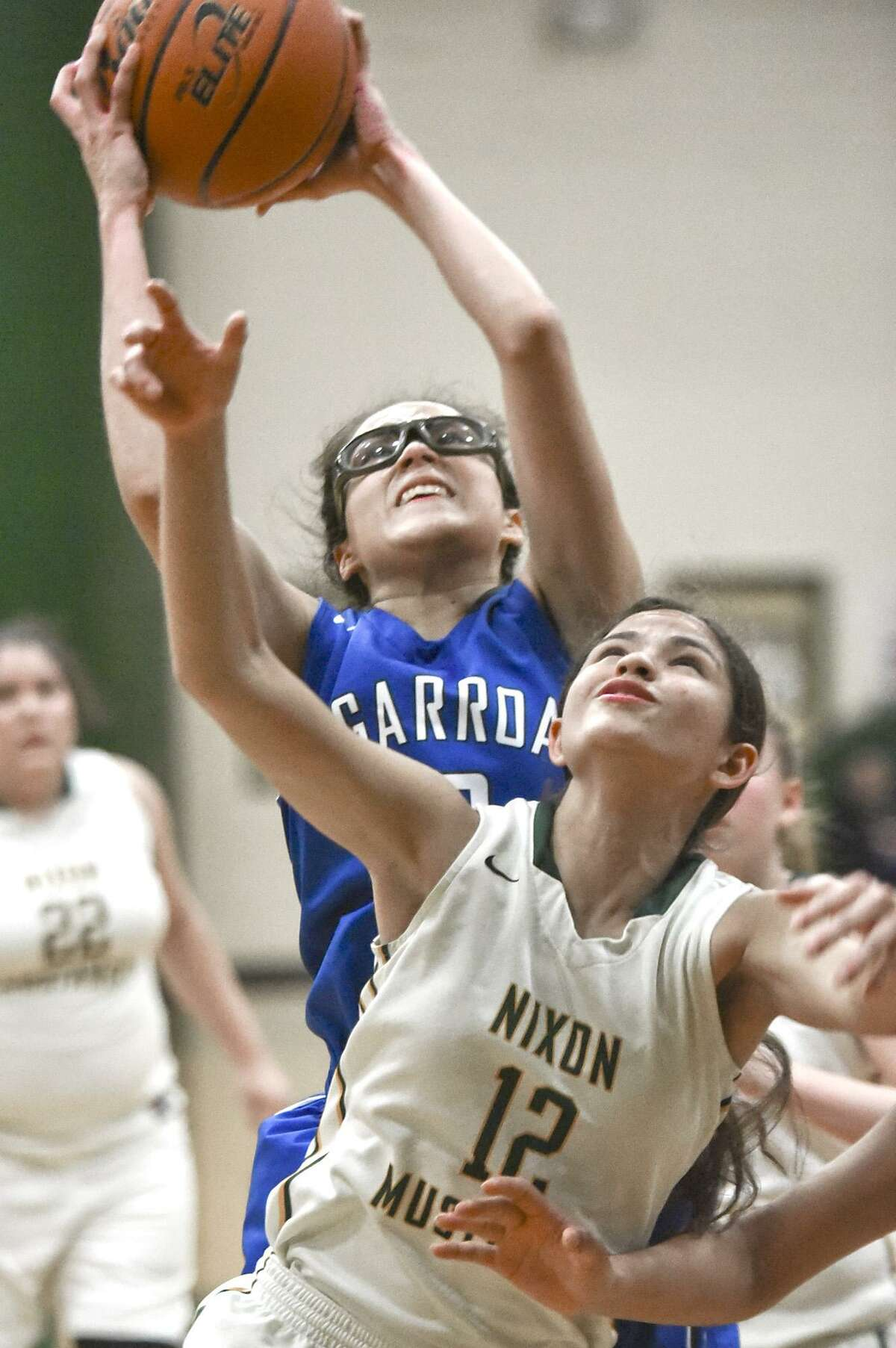 Leslie Alvarado sank two free throws late to help Cigarroa win 51-47 over Nixon for its 30th straight district win.