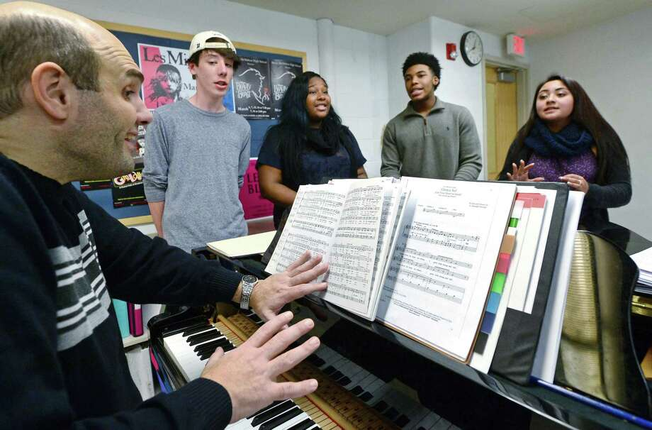 Frank Arcari, production director and music teacher at Brien McMahon High School teaches his chamber choir class, including Sebastian Cunningham, Sahai Lara, Cameron Kelly, and Sophie Starkman, at the school Thursday, December 8, 2016, in Norwalk, Conn. Members of the Brien McMahon drama community have raised over $16,000 on a GoFundMe page this year to use as seed money to get its season of musical productions started. This is the first time the school has been forced to have a major fundraiser in five years as a means of replenishing funds for their drama productions. Photo: Erik Trautmann / Hearst Connecticut Media / Norwalk Hour