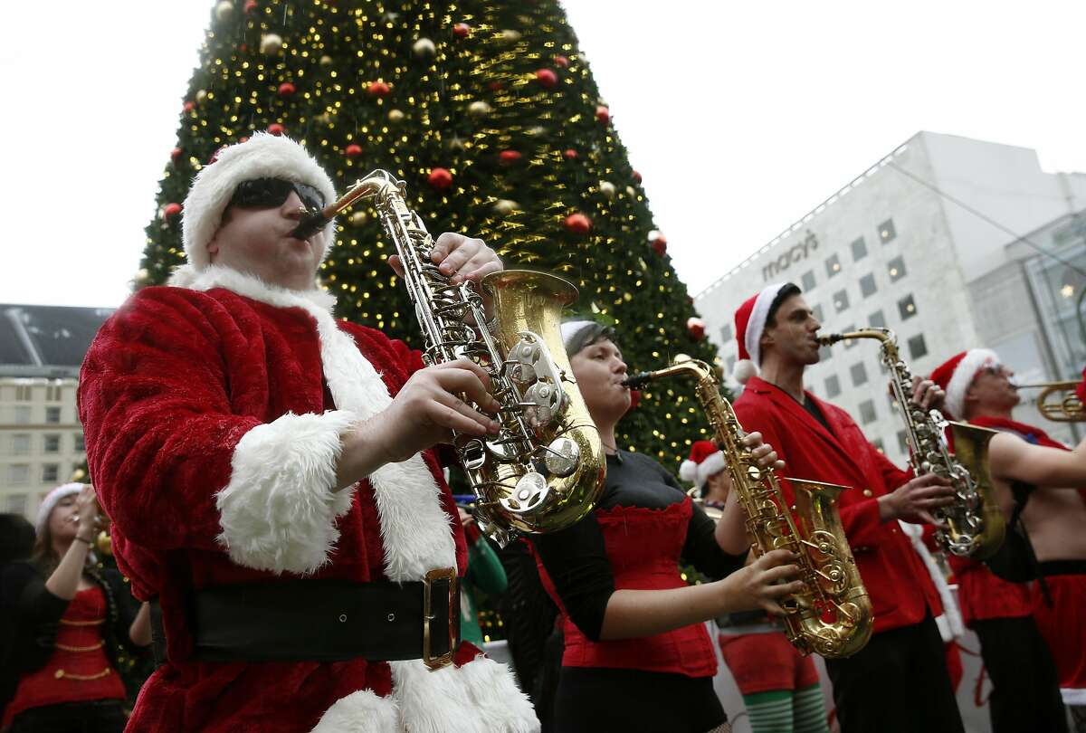 The Burlesque Band of San Francisco entertains multiple Santa Clauses at Union Square for the annual Santacon romp in San Francisco, Calif. on Saturday, Dec. 10, 2016.