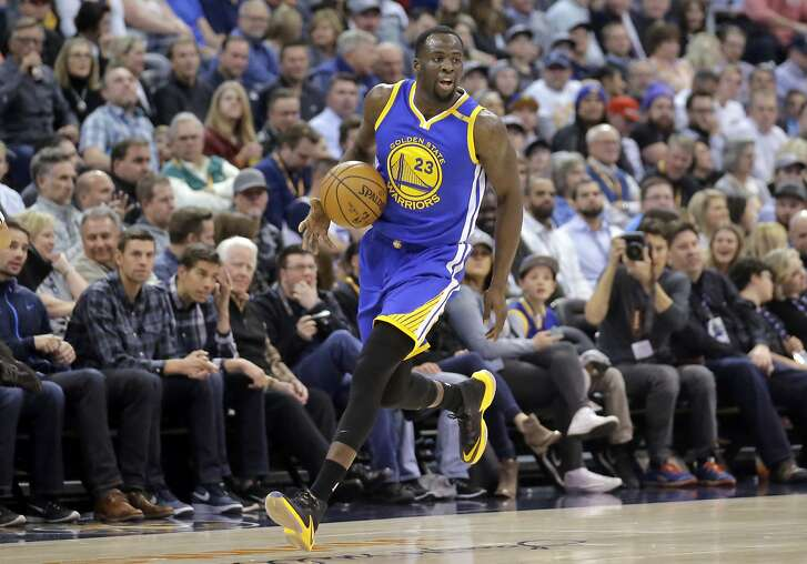 Golden State Warriors forward Draymond Green (23) drives against the Utah Jazz in the first half during an NBA basketball game Thursday, Dec. 8, 2016, in Salt Lake City. (AP Photo/Rick Bowmer)