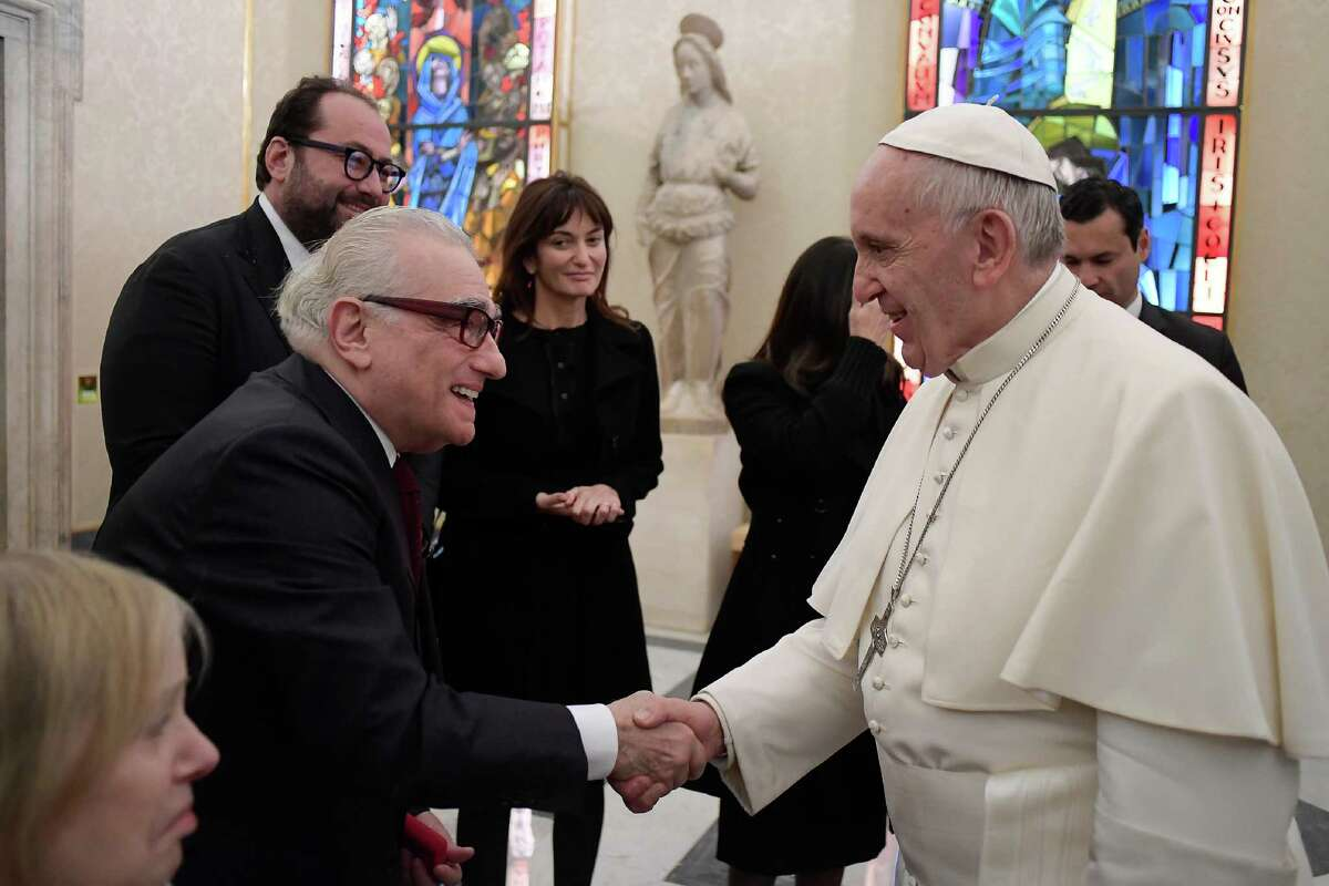 """This handout picture released by the Vatican press office shows Pope Francis during a meeting with US director Martin Scorsese, on November 30, 2016 at the Vatican. Martin Scorsese is in Rome to present his latest film """"Silence"""" to an audience of 400 Jesuits as part of a private screening. """"Silence"""", an adaptation of Shusaku Endo's 1966 novel of the same name, tells the story of two Jesuit missionaries (played by Andrew Garfield and Adam Driver) who visit 17th century Japan in the footsteps of their mentor (Liam Neeson). The film is due for release in the United States on December 23. / AFP PHOTO / OSSERVATORE ROMANO AND AFP PHOTO / HO / RESTRICTED TO EDITORIAL USE - MANDATORY CREDIT """"AFP PHOTO / OSSERVATORE ROMANO"""" - NO MARKETING NO ADVERTISING CAMPAIGNS - DISTRIBUTED AS A SERVICE TO CLIENTS HO/AFP/Getty Images"""