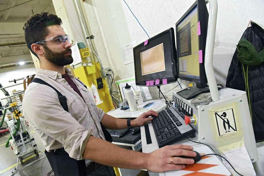 Keegan Goodell works at his program machine at Inova where he works on Thursday, Dec. 8, 2016 in Altamont, N.Y. (Lori Van Buren / Times Union) Photo: Lori Van Buren / 20039095A