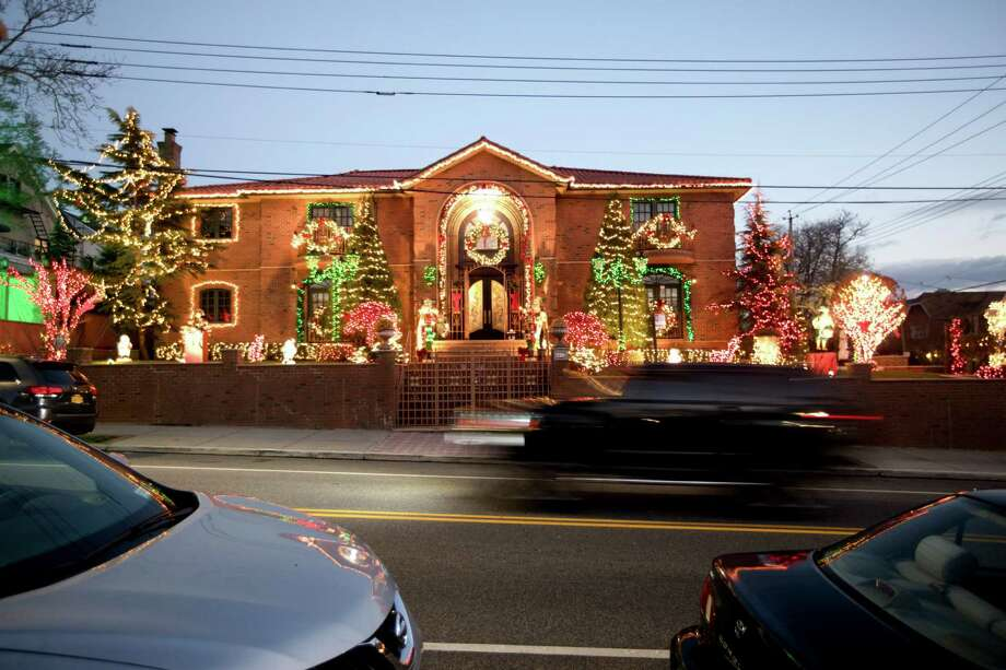 A house adorned in Christmas lights in Brooklyn, Dec. 2, 2016. In December, when the 86th Street neighborhood swells with visitors drawn to the ornate Christmas decorations adorning house after house, the parking problems — just like the holiday lights — grow larger than life. (Demetrius Freeman/The New York Times) ORG XMIT: XNYT231 Photo: DEMETRIUS FREEMAN / NYTNS