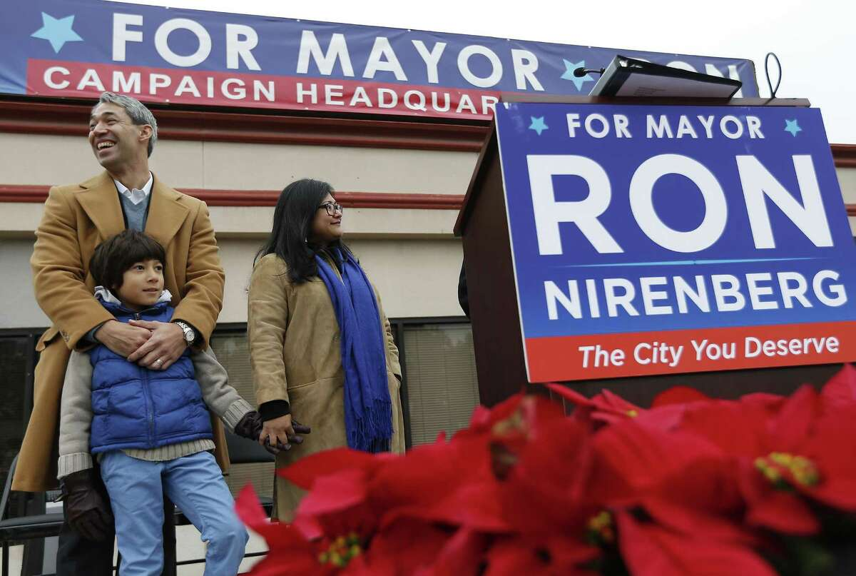 """District 8 Councilman Ron Nirenberg along with his wife, Erika and eight-year-old son, Jonah, announces his intention to run for city mayor to a large crowd gathered on Saturday, Dec. 10, 2016. Introduced by several VIPs and his wife, Erika, Nirenberg casted aside rumors and talk of his desire to be mayor. Nirenberg wasted little time in firing the first shot against Mayor Ivy Taylor as he brought up the issue of ethic violations against Taylor which Nirenberg and District 4 Councilman Rey Saldana were the only two opposing votes that effectively gave a pass to Taylor. Nirenberg touched on the city's population growth, economic opportunity, partnering with public school systems and on forging a transportation plan. """"I want more to say that I love it here (San Antonio) and I wouldn't live anywhere else,"""" Nirenberg said during his speech. (Kin Man Hui/San Antonio Express-News)"""