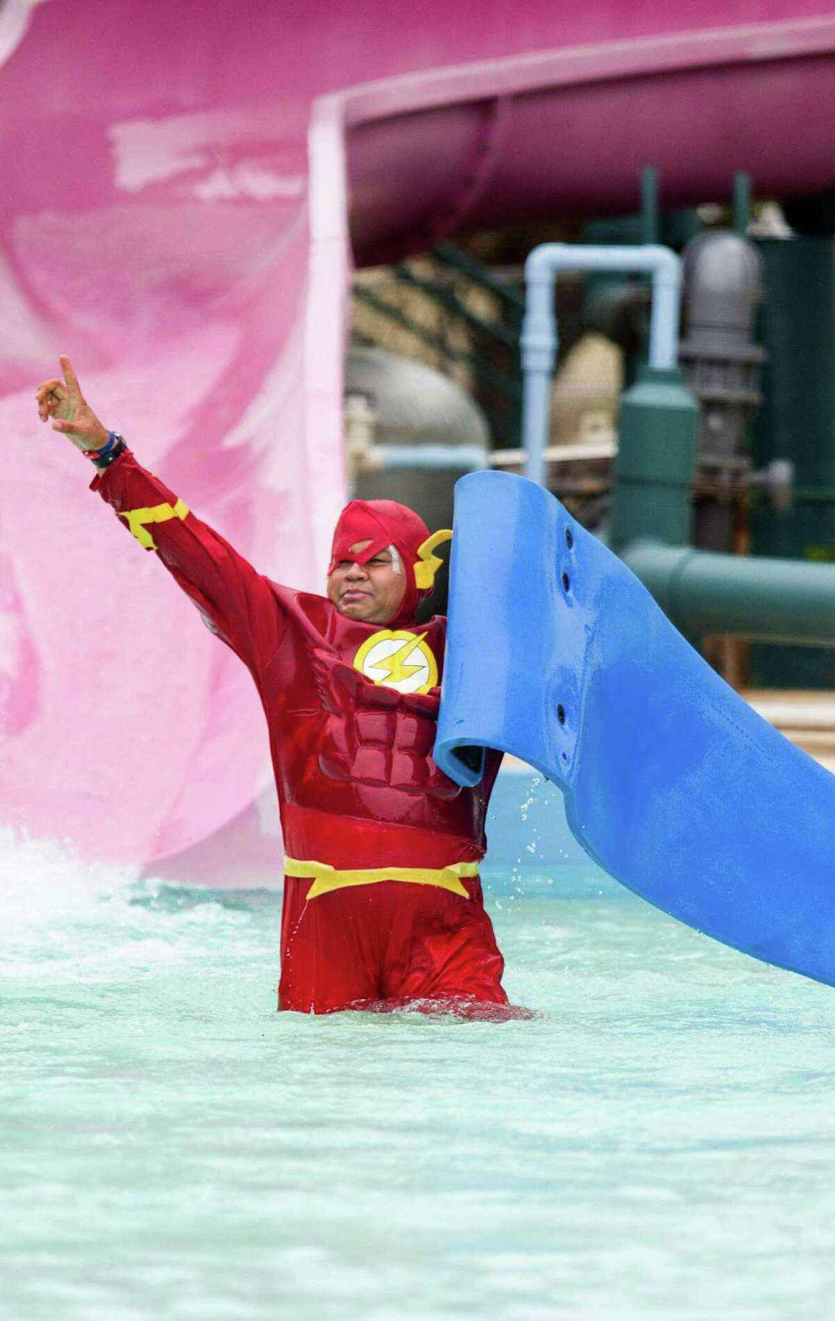 Dean Babcock raises his hand in the air after going down a slide during the Special Olympics Texas Polar Plunge at Splashtown in San Antonio, Texas on December 10, 2016. Ray Whitehouse / for the San Antonio Express-News
