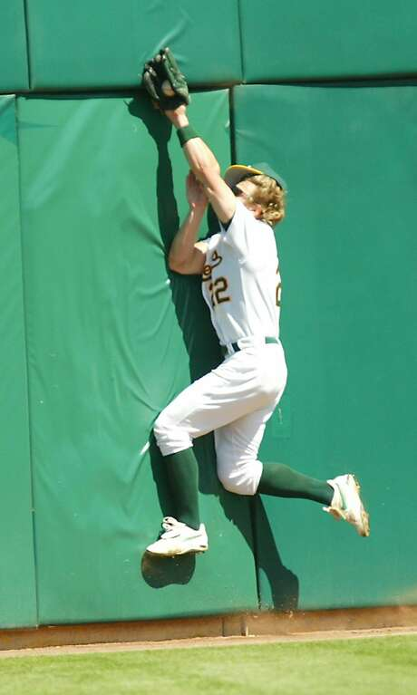 Byrnes, crashing into the outfield wall in 2003 with the A's, was known for his all-out style of play. Photo: GEORGE NIKITIN, AP