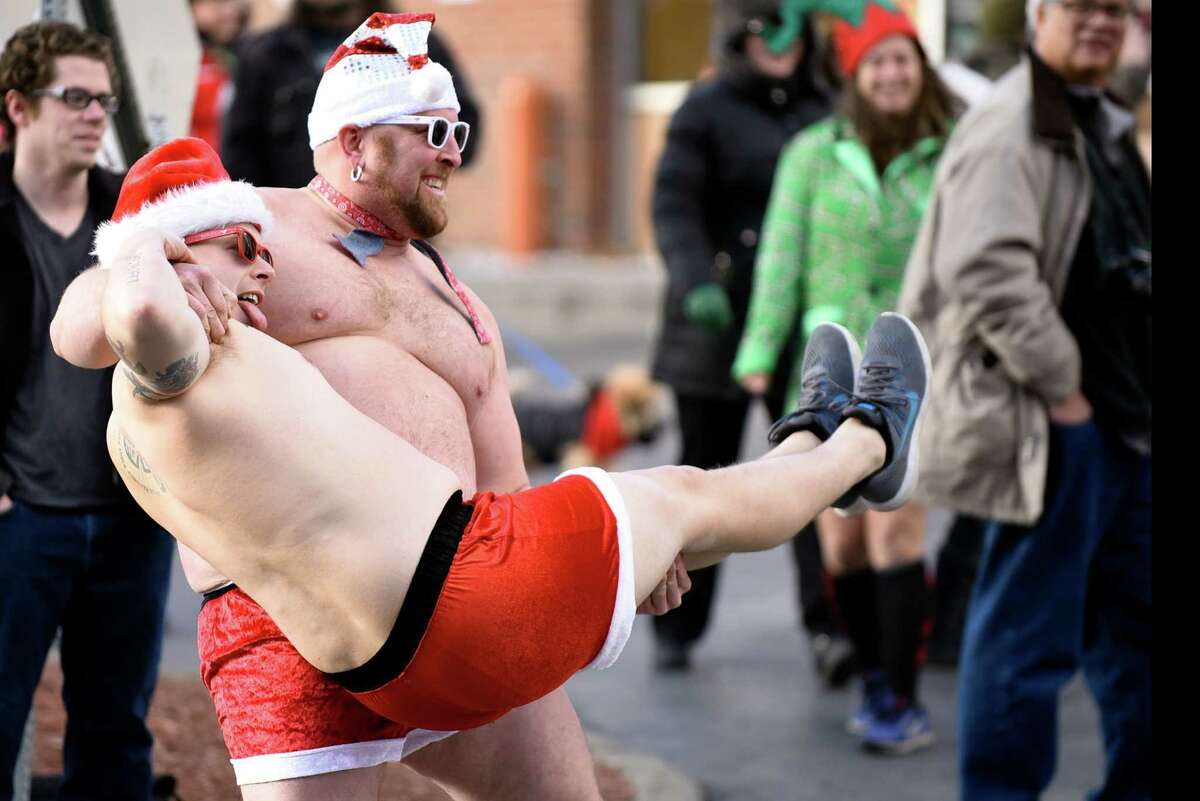 Joshua Nelson, left, and Jameson Williams, both of Saratoga Springs, pose for the cameras during the 11th annual Santa Speedo Sprint on Saturday, Dec. 10, 2016, on Lark Street in Albany, N.Y. The 800-meter run, organized by the Albany Society for the Advancement of Philanthropy, raises funds for the Albany Damien Center and HIV/AIDS program at Albany Medical Center. (Cindy Schultz / Times Union)
