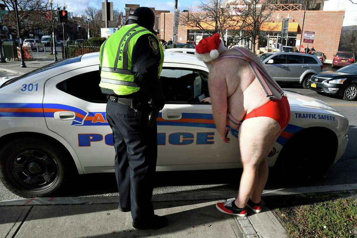 Race Director Jim Larson, right, finalizes plans with Albany Police officers before the 11th annual Santa Speedo Sprint on Saturday, Dec. 10, 2016, on Lark Street in Albany, N.Y. The 800-meter run, organized by the Albany Society for the Advancement of Philanthropy, raises funds for the Albany Damien Center and HIV/AIDS program at Albany Medical Center. (Cindy Schultz / Times Union)