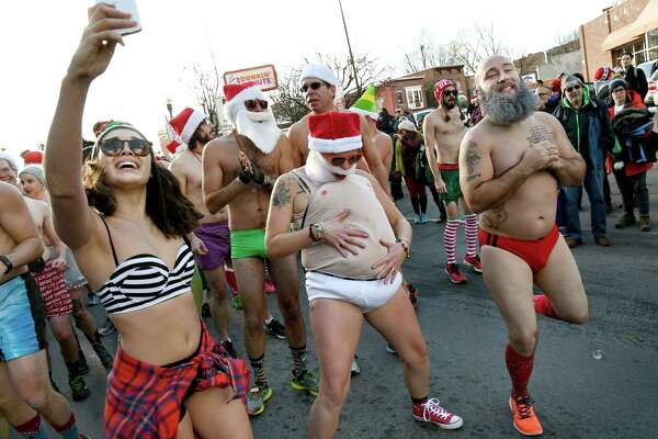 Race participants gather for the 11th annual Santa Speedo Sprint on Saturday, Dec. 10, 2016, on Lark Street in Albany, N.Y. The 800-meter run, organized by the Albany Society for the Advancement of Philanthropy, raises funds for the Albany Damien Center and HIV/AIDS program at Albany Medical Center. (Cindy Schultz / Times Union)