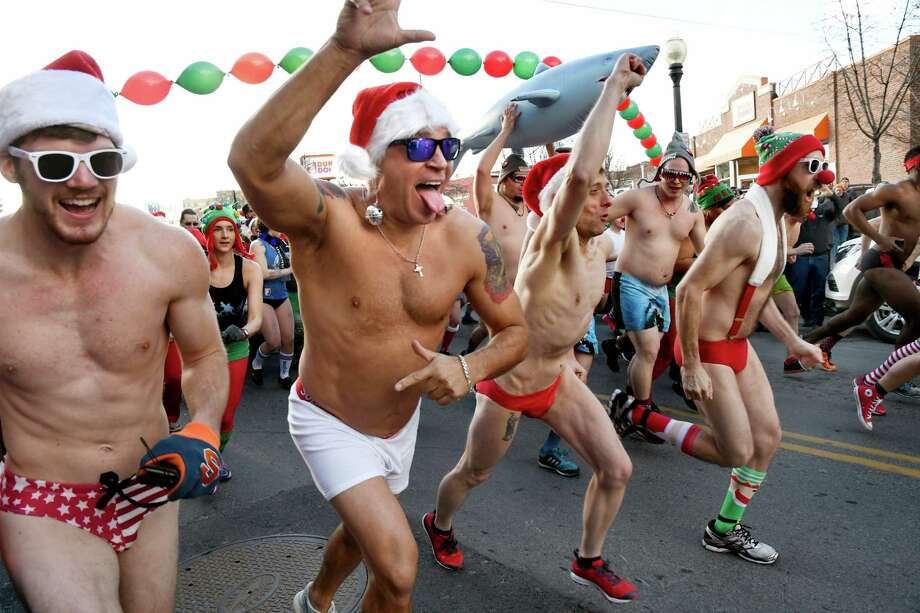Race participants start the 11th annual Santa Speedo Sprint on Saturday, Dec. 10, 2016, on Lark Street in Albany, N.Y. The 800-meter run, organized by the Albany Society for the Advancement of Philanthropy, raises funds for the Albany Damien Center and HIV/AIDS program at Albany Medical Center. (Cindy Schultz / Times Union) Photo: Cindy Schultz / Albany Times Union
