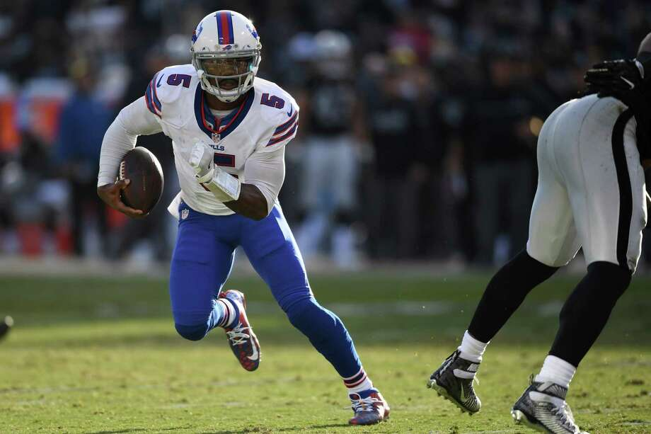 OAKLAND, CA - DECEMBER 04:  Tyrod Taylor #5 of the Buffalo Bills rushes with the ball against the Oakland Raiders during their NFL game at Oakland Alameda Coliseum on December 4, 2016 in Oakland, California.  (Photo by Thearon W. Henderson/Getty Images) ORG XMIT: 681233487 Photo: Thearon W. Henderson / 2016 Getty Images