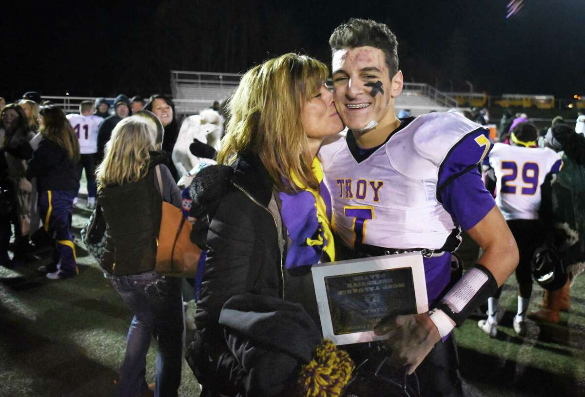Defensive player of the game, Troy QB #7 Joe Casale gets a kiss from his mother Kathy Casale after Troy won their State Class AA quarterfinal against Newburgh Free Academy at Dietz Stadium in Kingston, NY. (John Carl D'Annibale / Times Union)