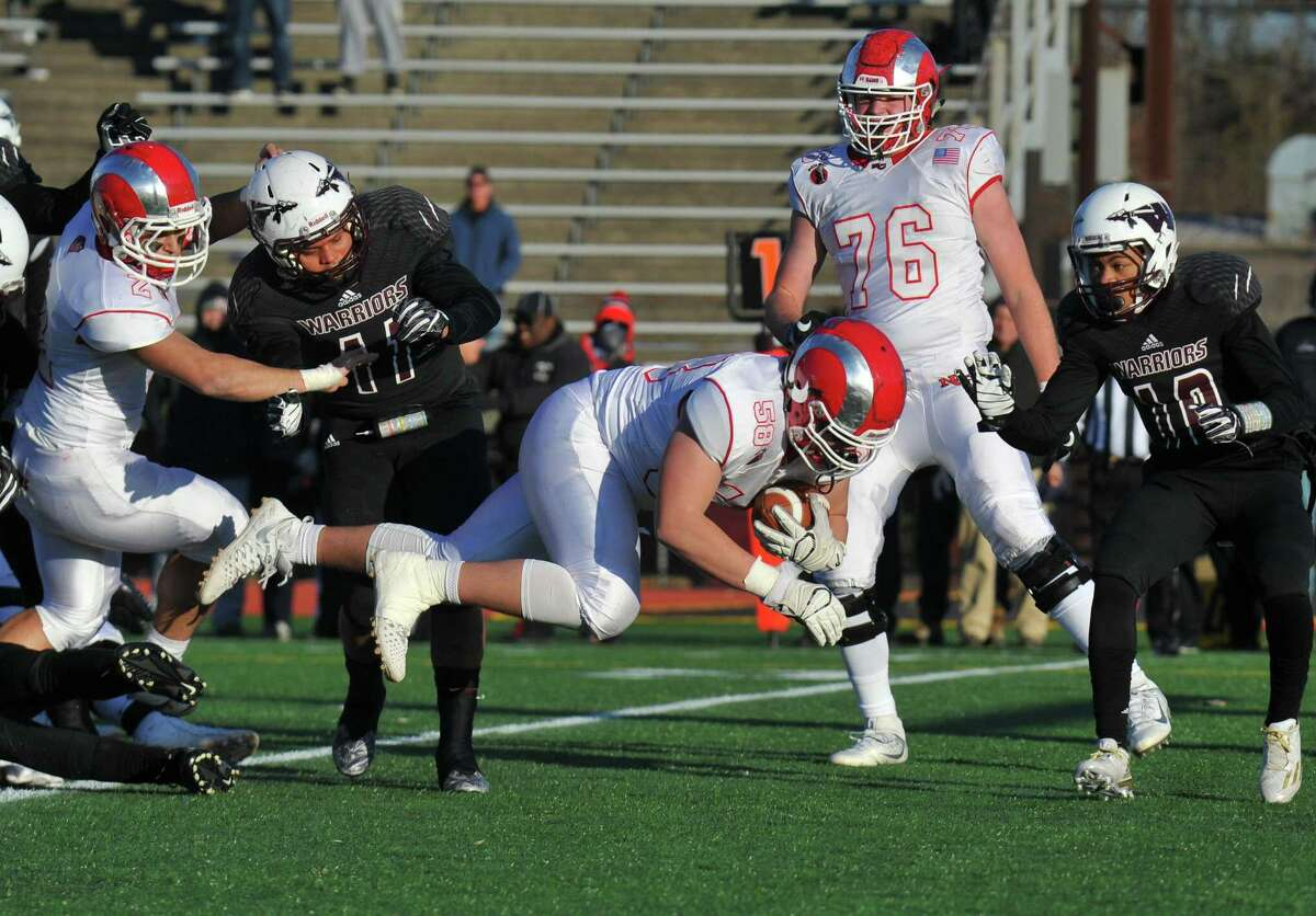 New Canaan's Teddy Hood sails into the endzone for a touchdown during the Class L championship game against Windsor on Saturday in New Britain.