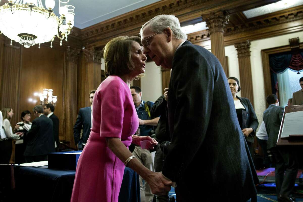 FILE - In this Dec. 8, 2016 file photo, House Minority Leader Nancy Pelosi of Calif. speaks with Senate Majority Leader Mitch McConnell, of Ky. on Capitol Hill in Washington. The 114th Congress has limped to a close, two years of partisan acrimony punctuated by the occasional burst of bipartisan deal-making in the waning days of President Barack ObamaÂ?'s tenure. (AP Photo/Cliff Owen, File)