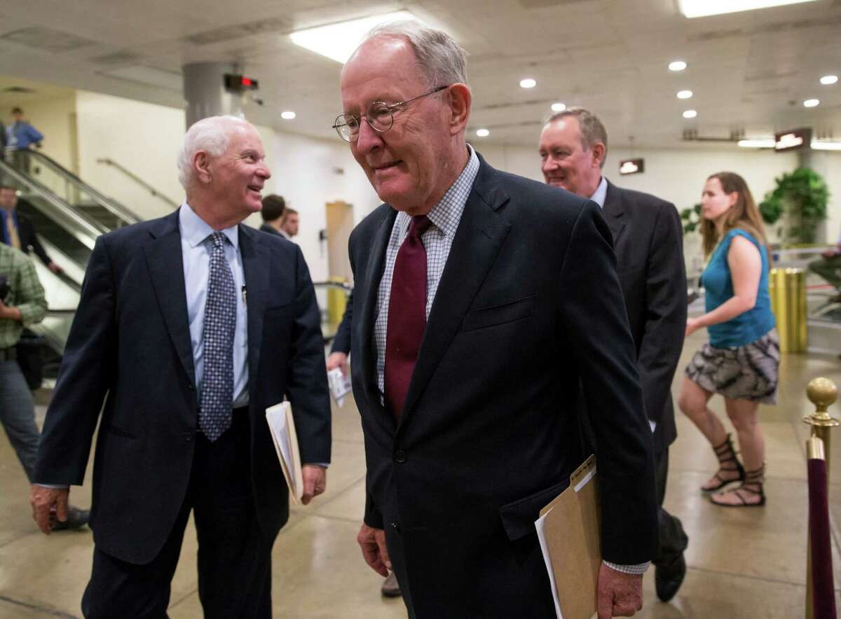 FILE - In this June 29, 2016 file photo, Sen. Lamar Alexander, R-Tenn. walks on Capitol Hill in Washington. The 114th Congress has limped to a close, two years of partisan acrimony punctuated by the occasional burst of bipartisan deal-making in the waning days of President Barack ObamaÂ?'s tenure. (AP Photo/J. Scott Applewhite, File)