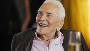 Actor Kirk Douglas reacts to a tribute at his 100th birthday party at the Beverly Hills Hotel on Friday, Dec. 9. 2016, in Beverly Hills, Calif. (Photo by Chris Pizzello/Invision/AP)