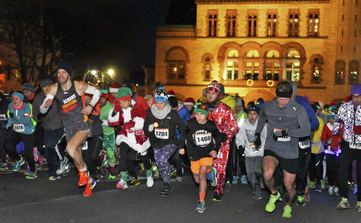 Runners begin the 20th annual Albany Last Run 5K in front of Albany City Hall Saturday Dec. 10, 2016 in Albany, NY. (John Carl D'Annibale / Times Union)