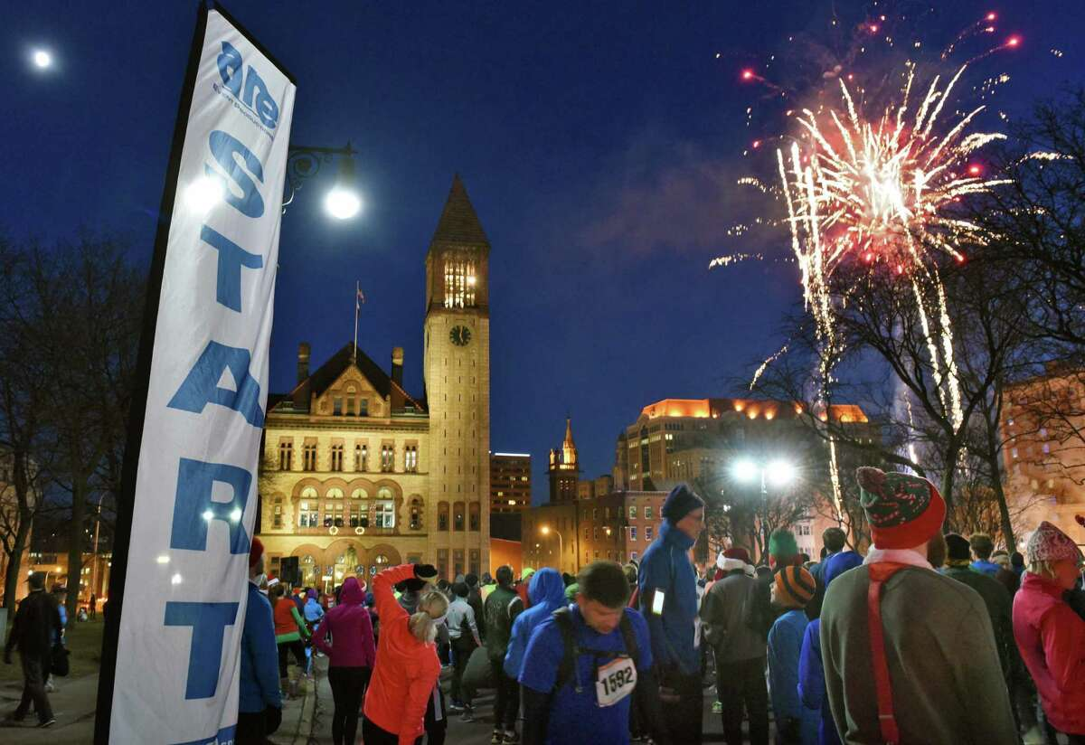 A fireworks show will kicks off the 20th annual Albany Last Run 5K in front of Albany City Hall Saturday Dec. 10, 2016 in Albany, NY. (John Carl D'Annibale / Times Union)