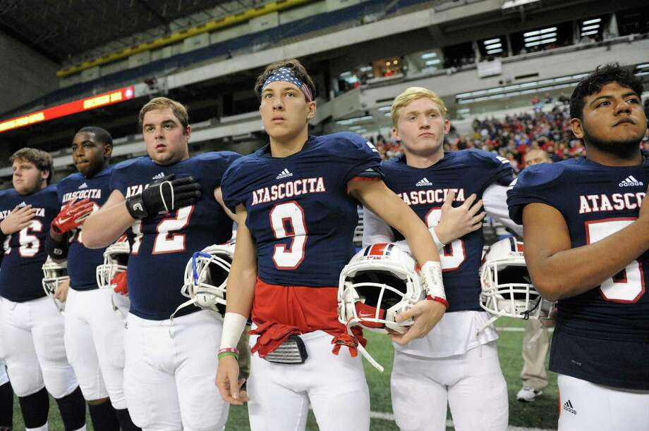 Randall Mccusker (9) and other Atascocita teammates stand at attention during the National Anthem before the Conference 6A Division I State Semi-Final playoff game between the Atascocita Eagles and the Lake Travis Cavaliers on Saturday December 10, 2016 at the Alamodome, San Antonio, TX. Photo: Craig Moseley, Houston Chronicle / ©2016 Houston Chronicle