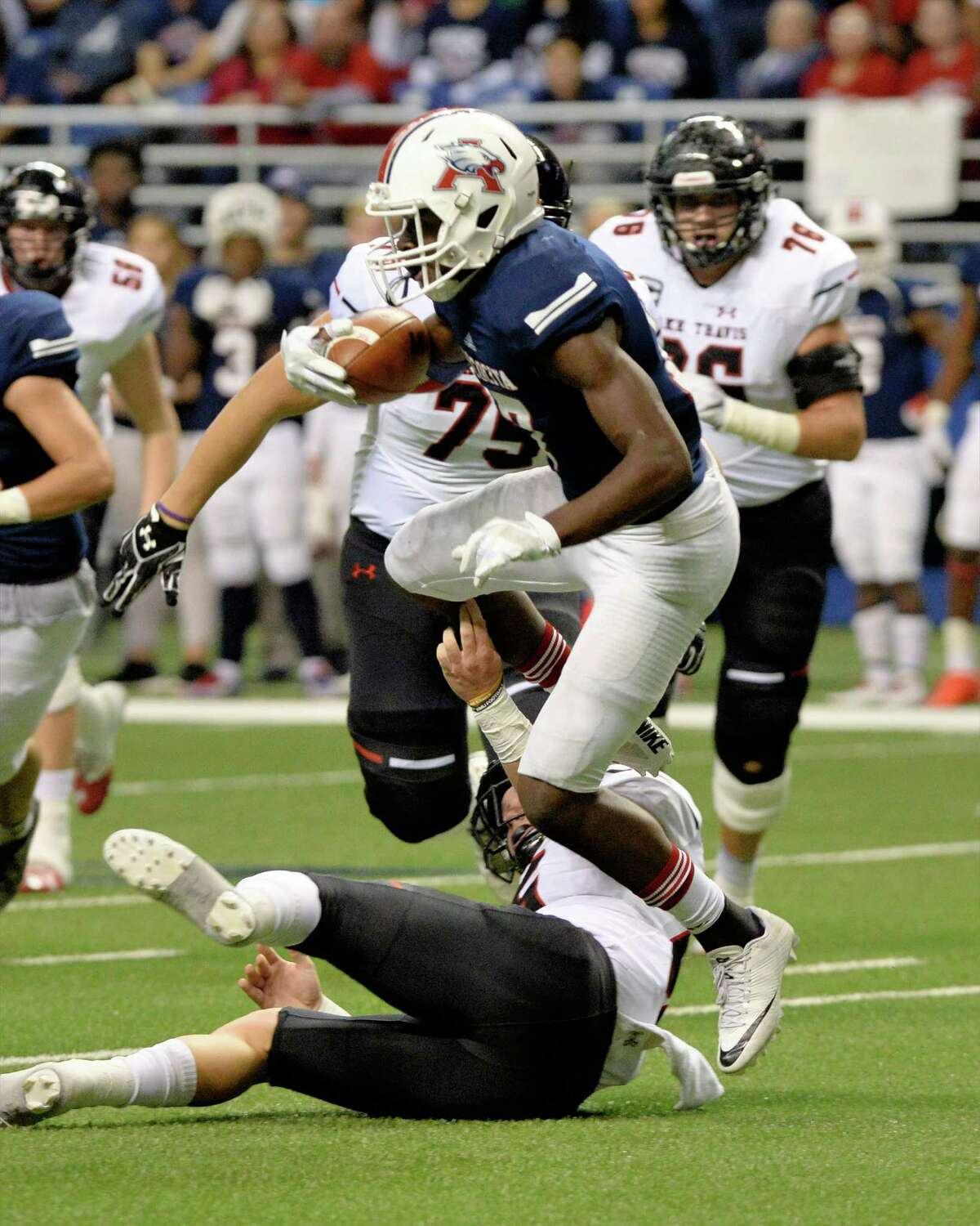 Alex Morris (17) of Atascocita carries the ball after recovering a field goal attempt by Lake Travis in the first half of the Conference 6A Division I State Semi-Final playoff game between the Atascocita Eagles and the Lake Travis Cavaliers on Saturday December 10, 2016 at the Alamodome, San Antonio, TX.