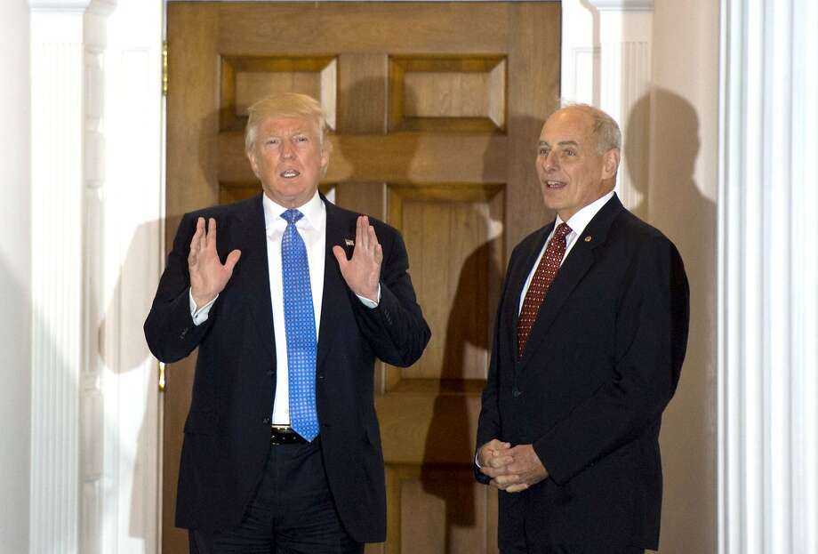 This file photo taken on November 20, 2016 shows US President-elect Donald Trump meeting with retired Marine Corps general John Kelly at the clubhouse of Trump National Golf Club in Bedminster, New Jersey. Photo: DON EMMERT, AFP/Getty Images