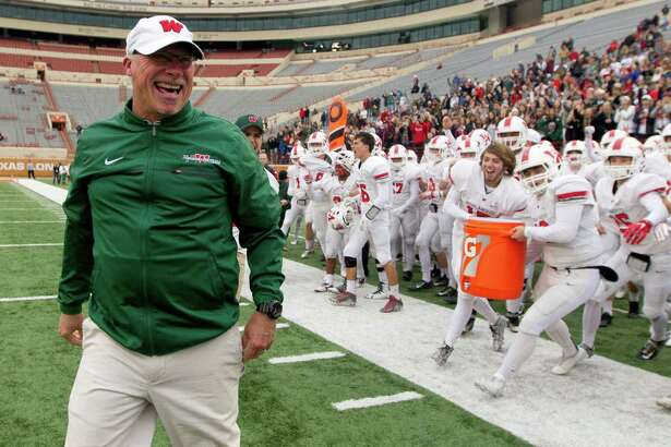 The Woodlands head coach Mark Schmid yells in celebration after the Highlanders knocked off Allen 36-28 in a Class 6A Division I state semifinal game at Darrell K Royal-Texas Memorial Stadium Saturday, Dec. 10, 2016, in Austin.