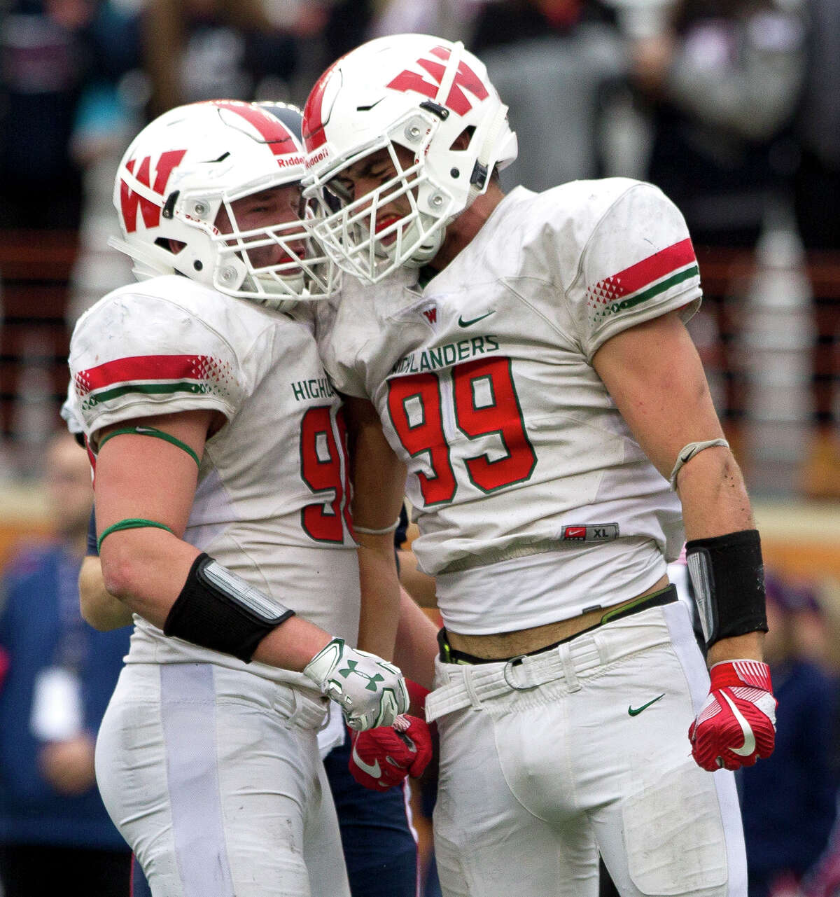 The Woodlands defensive linemen Michael Purcell (99) celebrates with defensive linemen Zachary Loane (90) after sacking Allen quarterback Mitchell Jonke (2) for the second time in three plays during the fourth quarter of a Class 6A Division I state semifinal game at Darrell K Royal-Texas Memorial Stadium Saturday, Dec. 10, 2016, in Austin. Purcell finished the game 2.5 sacks, three tackles for loss, six overall tackles and a pass breakup.
