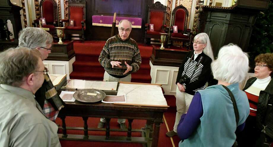 Jim Folts, president of the Board of Trustees, center, shows original documents and artifacts during an Alexander Hamilton themed tour on Saturday, Dec. 10, 2016, at the First Church in Albany in Albany, N.Y. This was the first of the church's 375th anniversary year tours. (Cindy Schultz / Times Union) Photo: Cindy Schultz / Albany Times Union