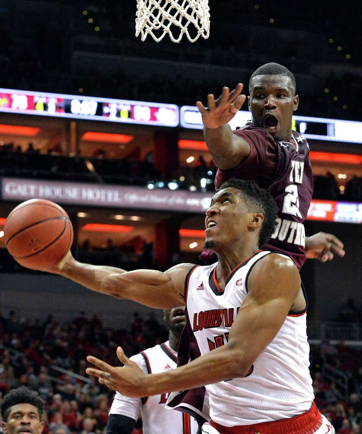 Texas Southern's Derrick Griffin, who had 26 rebounds, puts pressure on Louisville's Donovan Mitchell, who goes in for a layup in the second half.
