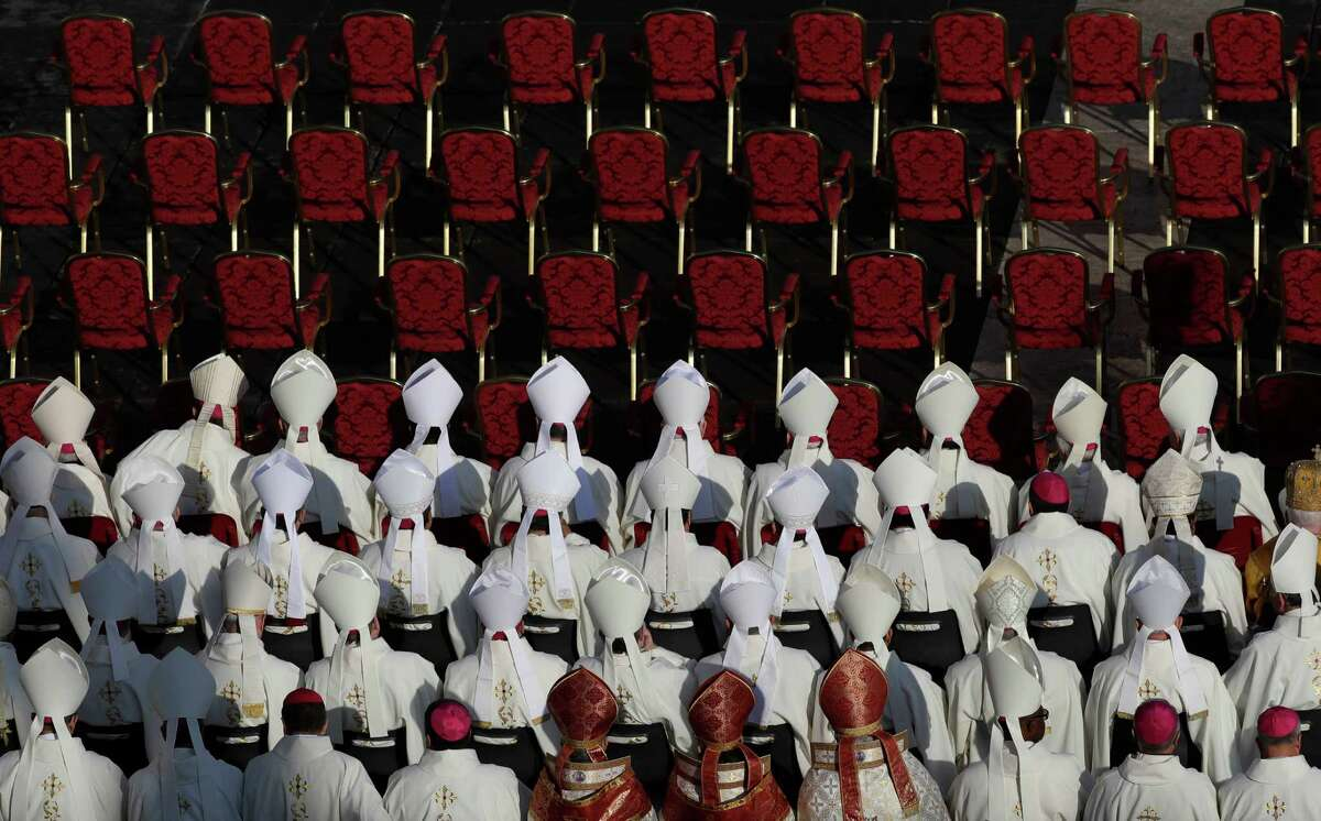 Bishops sit before a Mass celebrated by Pope Francis on the occasion of the closing of the Holy Door of St. Peter's Basilica at the Vatican, Sunday, Nov. 20, 2016. The Holy Door closing marks the end of the Jubilee of Mercy. (AP Photo/Gregorio Borgia)