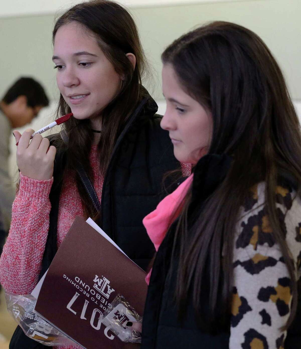 Melissa Chapman, left, and her friend Camila Llorente go through booths for college information at Houston Independent School District's second DREAM Summit Saturday, Dec. 10, 2016, in Houston. Melissa, a 18-year-old junior at Westside High School, immigrated to the U.S. about a-year-and-half ago from Colombia. Nonprofit organizations and college officials were on site to provide students with information about financial aid, student housing, applications and options.